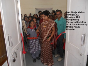 Principal inaugurating Book Fair along with students and Librarian